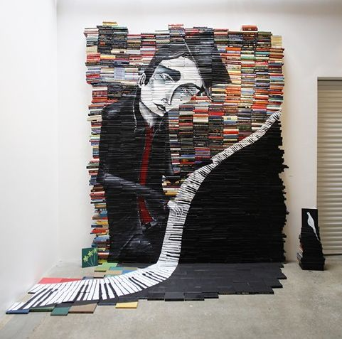 Mike Stilkey creates sculptures, installments, and paintings using stacked books. Love.