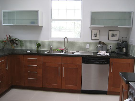 IKEA Adel medium brown kitchen cabinets  green mosaic tile