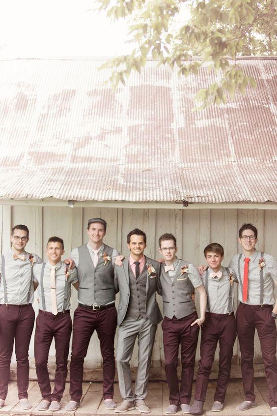 Cool groomswear for barn wedding, with flat cap, braces and waistcoasts