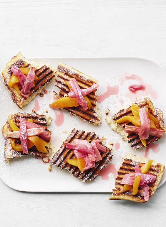 Try our griddle-pan waffle recipe topped with roasted rhubarb and mango for a delightful weekend brunch with friends and family.