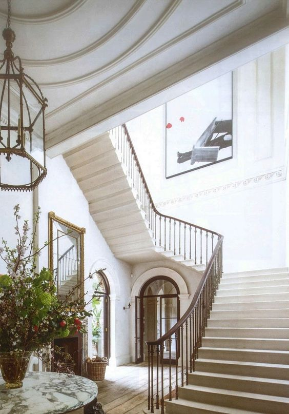 Magnificent classical architecture in this stairway in Rose Uniacke's Classic Minimal Home in London.