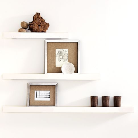 "Picture ledge shelves from West Elm.  They're 3.5"" deep and come in 2', 3' and 4' lengths.  I love them for framed family photos!"