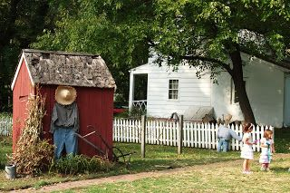 Love the scarecrow against the shed!