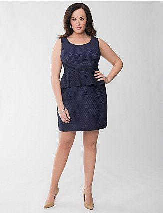 Get ready to wow in our flattering lace peplum dress! This of-the-moment style is a must for the season with a shape made for curves, scoop neck and seamed waist. Edgy design includes an exposed back zipper and geometric lace with contrasting liner for a pop of color.  lanebryant.com
