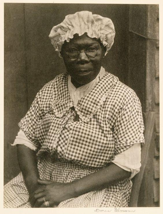Black Woman in Cap and Gingham Dress by Doris Ulmann