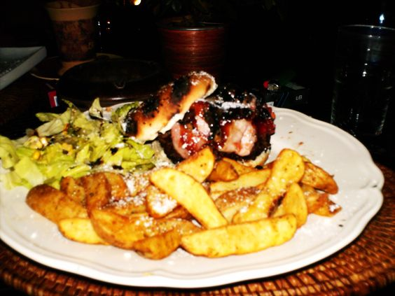 BBQ cheese stuffed Burger with Potato Wedges and salad in Kriopigi, Greece
