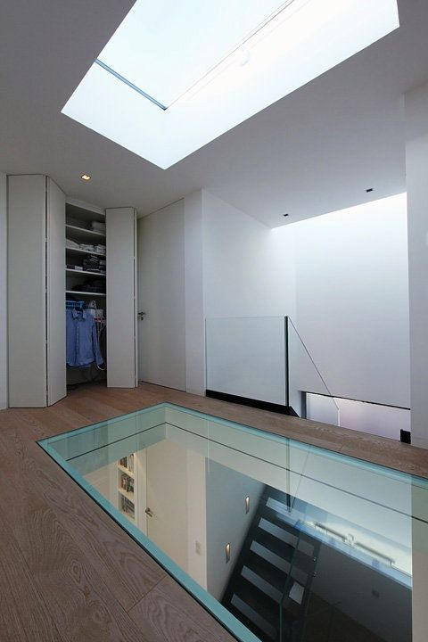 Glass floor to showcase cellar below cellar for Floor to ceiling glass