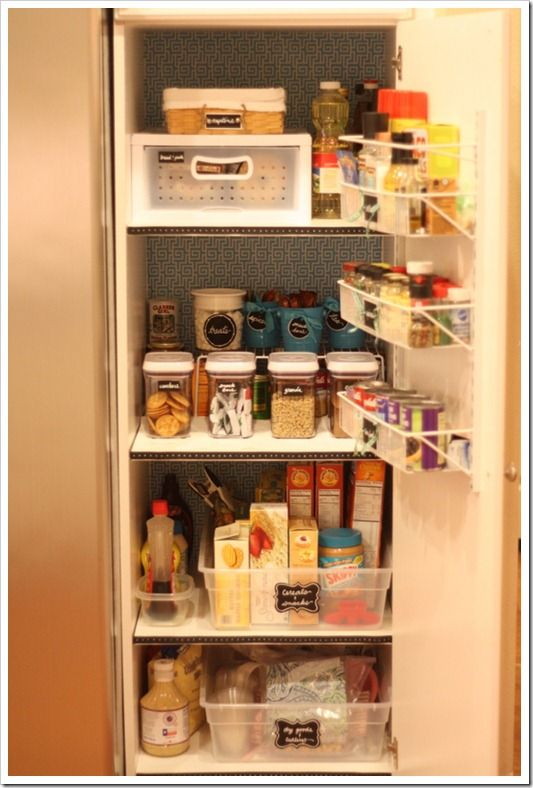 Org's pantry, love the wall paper on the back wall, pull out drawer for bread and pasta, long plastic bins instead of expensive pullout shelves, and labels, labels, labels!