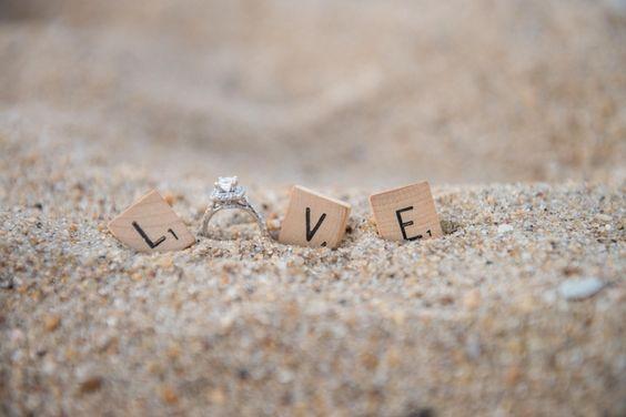 21 Creative Engagement Ring Photo Ideas: Beach wedding ring photo idea - ring in sand with Scrabble letters to spell out LOVE {Kristi Midgette Photography}