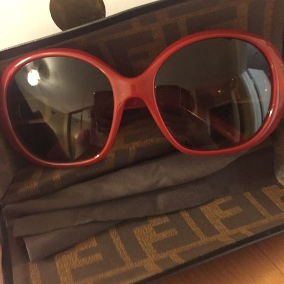 NWT FENDI red and gold sunglasses Brand new with no attached tags as was purchased online. FENDI red plastic frames with gold accent on sides. Comes shipped in original FENDI case with cleaning cloth. NO TRADES. FENDI Accessories Sunglasses