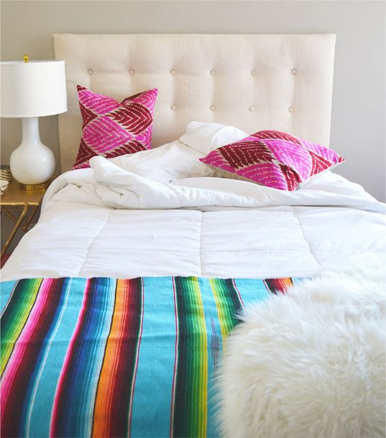 add a fun pop of color to a neutral bedroom with a mexican serape