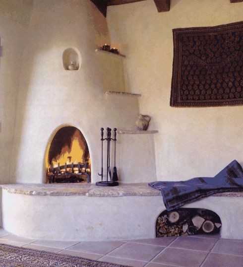 Kiva is perfection niches and narrow shelves stone for Southwestern fireplaces