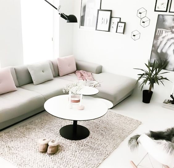 Scandinavian style living room with grey couch and a mixture of pastel cushions