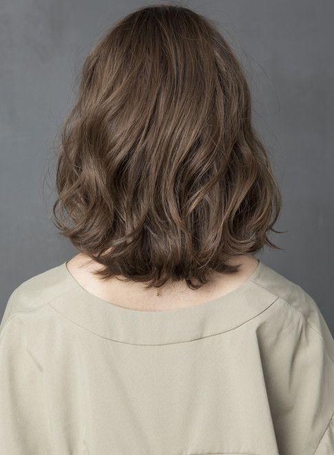 Các kiểu tóc xoăn cho người mặt to tròn