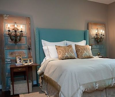 Salvaged doors with wall sconces.