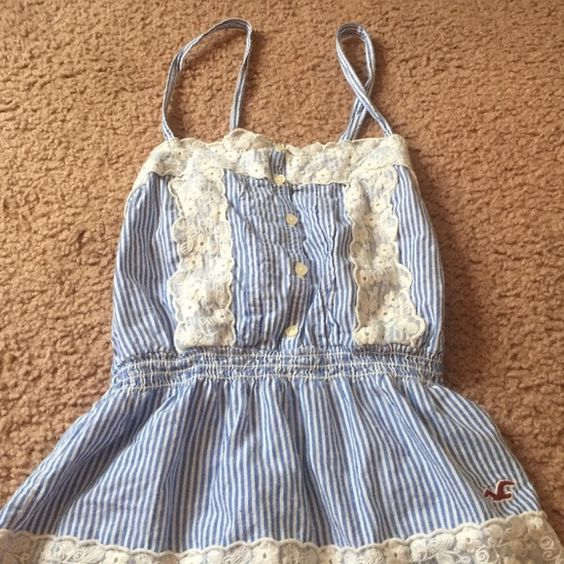 Striped racer back tank top White and blue stripped racer back tank top with lace detailing Hollister Tops Tank Tops