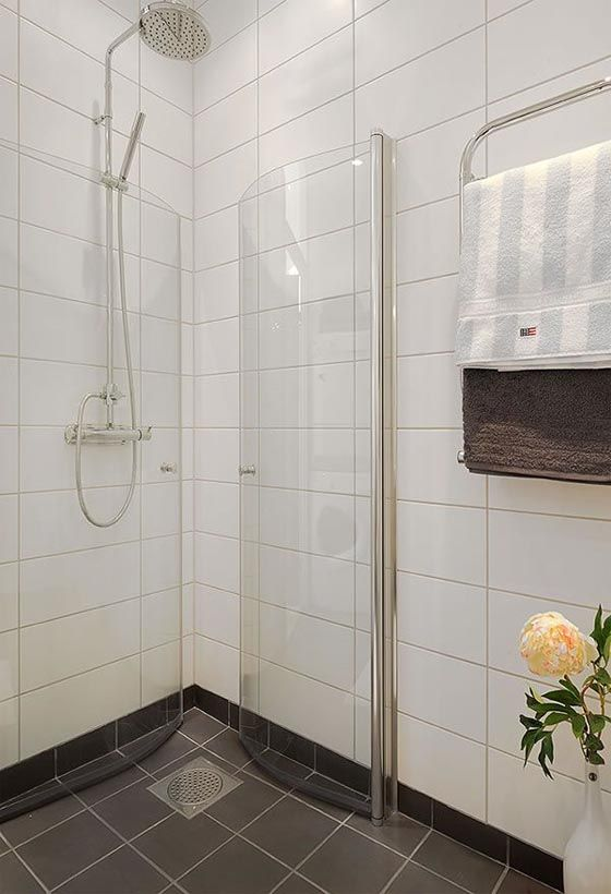 white walls + dark tile bathroom floor