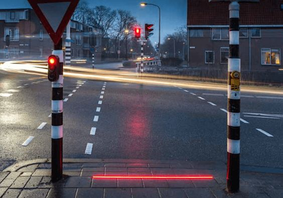 Sidewalk traffic lights designed for smartphone addicts appear in another location; this time they're bigger and brighter: