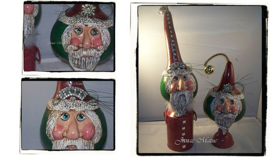 Two sculpted gourd Santa's on different tin cans that I created for Midway Swiss Christmas.