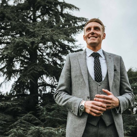 Mr Wyatt. The Groom had a 3 piece grey English tweed wedding made to measure suit designed at our Billericay branch. Slim fit styled with a scoop waistcoat and knitted tie.