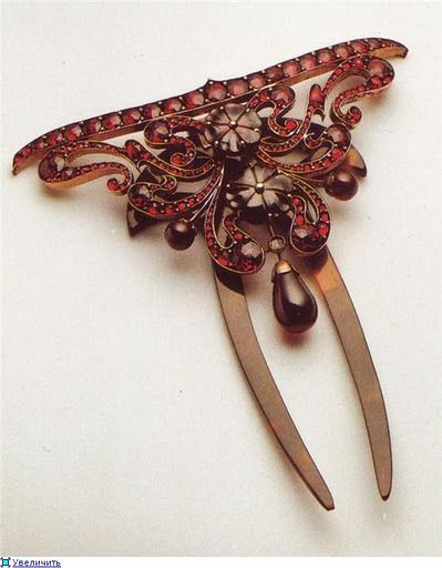 Garnet hair comb -- what a lovely piece.