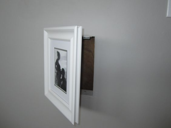 Instead of a regular Laundry Shoot Door...I used a picture frame and placed a picture that I can change out. Used a 8x10 Fram and attached the hinge to the frame and then to the wall.