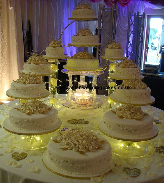 Big Wedding Cakes with Fountains | The cake is decorated with White roses with a classic gold edging. The ...