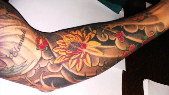 Gorgeous lotus flower sleeve tattoo...