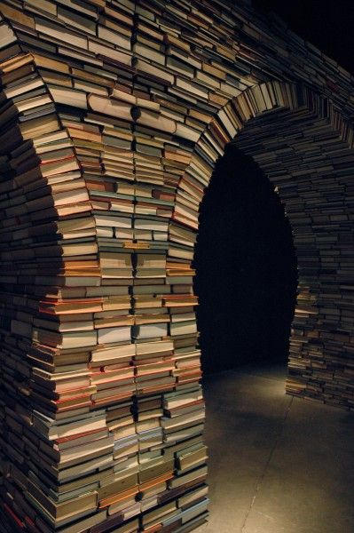 "Arches are a wonderfully stable architectural form.  Take a book out of the structure for reading, and the rest will remain standing.  Just remember to put it back, and make sure the ""keystone"" book is something so dull that you won't want to read it... the telephone book, perhaps?"