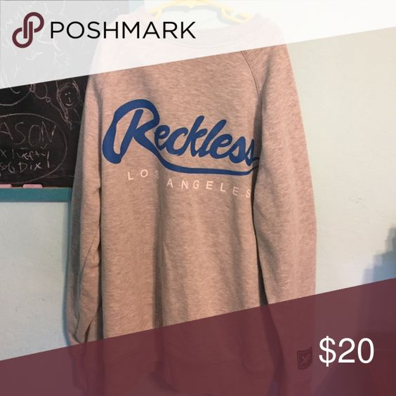 young & reckless sweatshirt 50% cotton / 50% polyester. Grey sweatshirt w/ blue writing Young & reckless Tops Sweatshirts & Hoodies