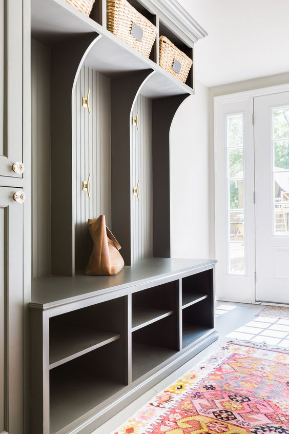 Foyer Mudroom Jobs : Grey cloakroom shelves with gold accents and colorful rug