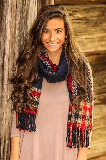Navy scarf with tan & red houndstooth print with fringe detail. The perfect scarf to keep you warm & cozy!