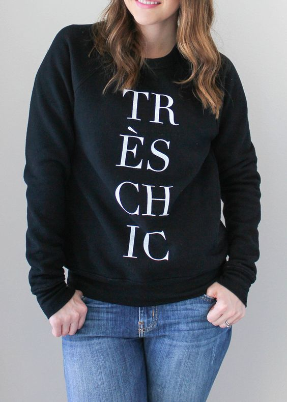 Tres Chic Sweatshirt - This cozy fleece sweatshirt is a must-have tee for fashionistas! This super soft, stylish tee will become an instant favorite in your wardrobe. It's perfect for a day out shopping or sipping coffee and flipping through your favorite fashion magazines. We also love that you can layer a coat or jacket over it without covering the design!