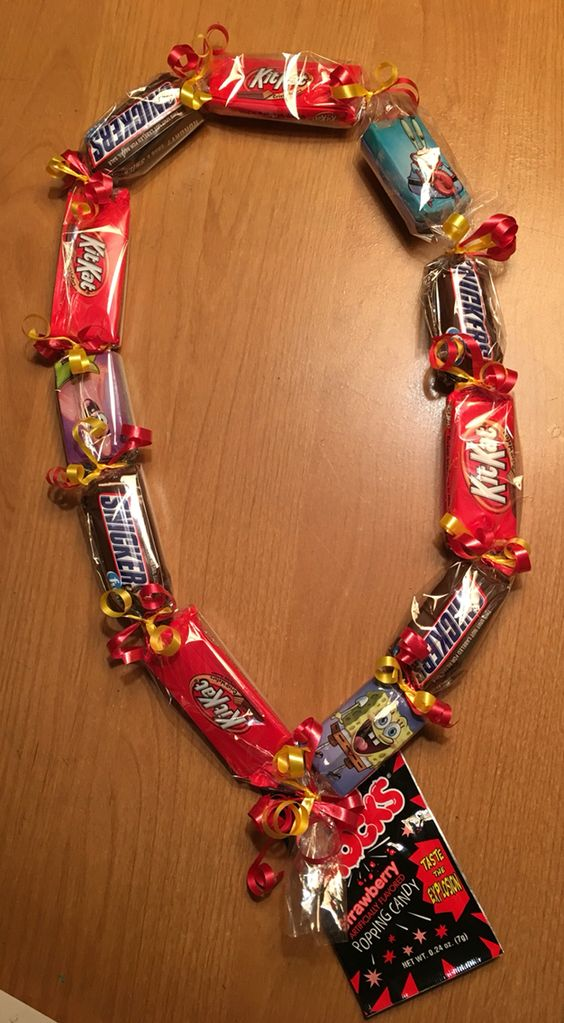 Graduation candy lei for kids. Smaller lei with sweet treats for the little graduates. What kid would NOT like this. Available for adults in larger size also. Pics available at FB/Miguel's Treasures and Etsy/migstreasures.