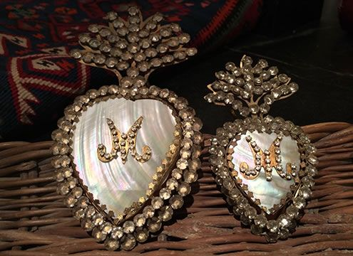 Two jeweled flaming heart shell reliquarios