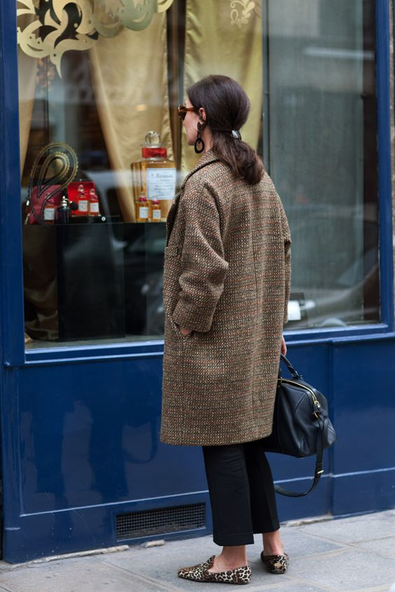 Great classic oval coat. Notice the earrings, glasses, and shoes to bring artistry that says who she is.: