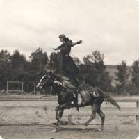 Cowgirl Tillie Baldwin trick riding vintage. This is called the Roman Stand.
