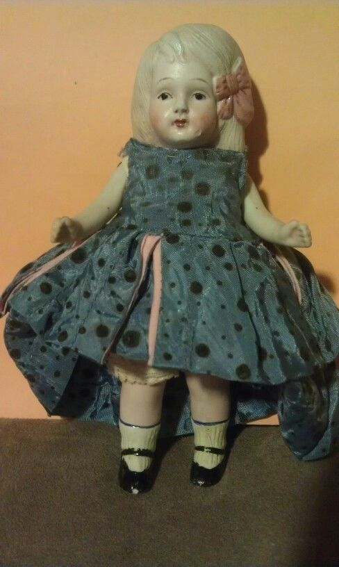 Small bisque antique doll.