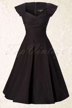 Das 50s Mad Men swing dress black von Stop Staring! Dies ist ein klassisches 1950s Stil Mad Men inspiriertes Kleid.Elegantes Kleid mit einer besonderen Halslinie, die dem Kleid das gewisse Etwas verleiht. Das Kleid hat süße kleine angerüschte Ärmel, ein figurbetontes Top und einen tollen auslaufenden Tellerrock. In diesem Kleid bekommen Sie eine echte Wespentaille! Das Kleid ist hergestellt aus topqualitativem Millennium Bengalin: ein dicker, luxuriöser ...