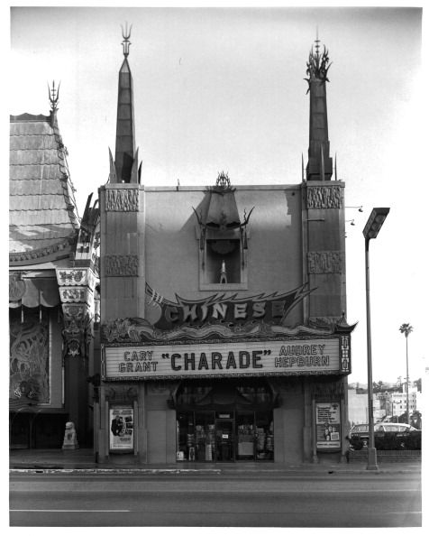 """Grauman's Chinese Theatre marquee spotlights """"CHARADE"""" starring Audrey Hepburn and Cary Grant, 1963."""