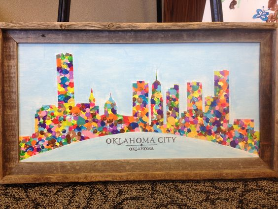 City outline filled in with fingerprints. Each child gets their own color. Create this with simple outline of Mt. Hood/town of Hood River & similar frame. Could also have printed into 5 X 7 cards for sale.