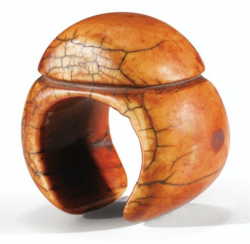 """Sotheby's is auctioning this marvellous bracelet from Cameroon. """"In the grasslands, ivory bracelets were worn by members of the nobility in pageants. Here, the elegance of the shape is accentuated by the fullness of the button and the red-brown shades of patina."""" Sale date: 11 December 2013"""
