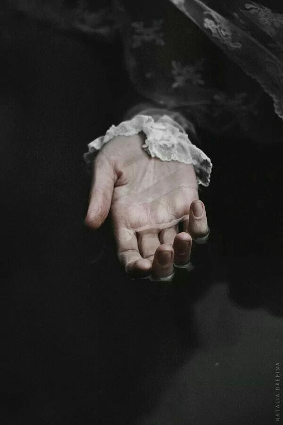 ophelia - hand in water with white lace
