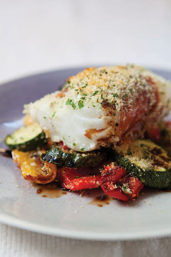 We love this brilliant low-fat, one-pan, supper from The Hairy Dieters cookbook. A roasted cod recipe with parma ham and peppers - delicious!