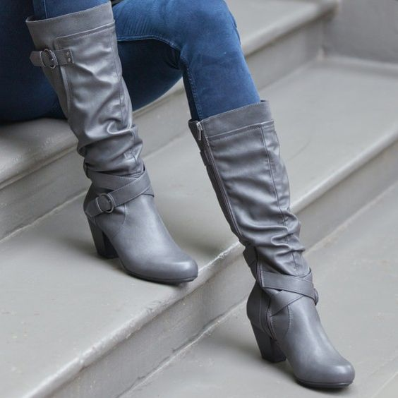 Boot features a full zip with elastic gore. Contrasting suedette panel on outer calf. A subtle velvet touch brings a fashion statement to this beautifully crafted boot. The shaft is embellished with two buckled straps. Rialto Shoes Coralynn Grey Boot Rialto