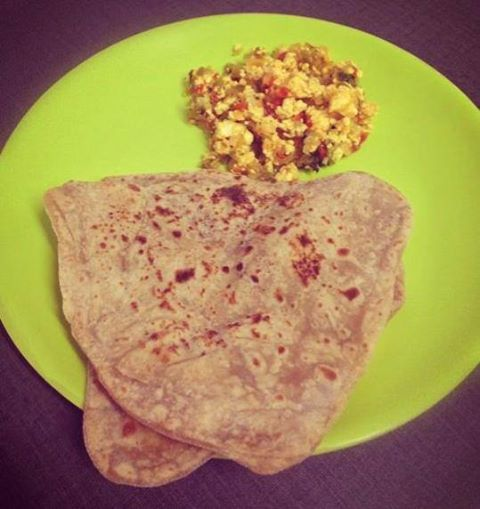 Try this paratha and paneer burji combo. Both are homemade. We only used miniscule amount of ghee inside the paratha (1/2 tsp between 4 parathas) but not while cooking it on the pan.  Also, we made the paneer at home with low fat milk and used less than 1/2 tsp oil for the burji seasoning. We added onions, tomatoes and green peppers. What veggies will you add?