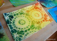 spray watercolor: diluted watercolor in spray bottles with doilies, sponges, stencils, etc.