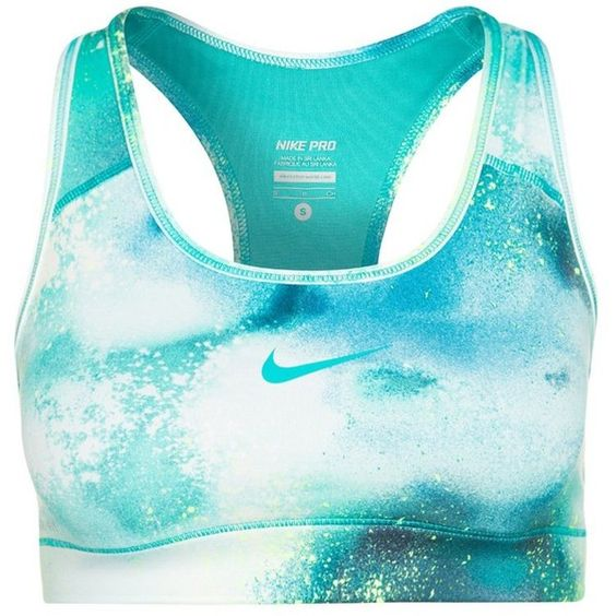 Nike Performance PRO SPLATTER Sports bra (£23) ❤ liked on Polyvore featuring activewear, sports bras, tops, bras, sports, shirts, green, green sports bra, blue shirt and nike sportswear