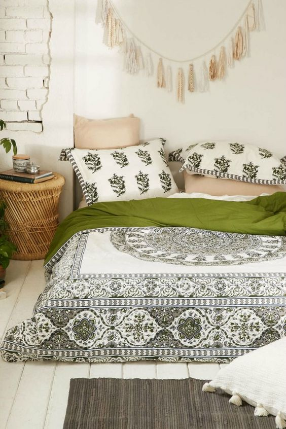 Delightful green patterns keeps this bohemian bedroom from being too underwhelming