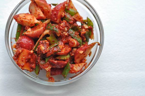 Easy Peasy Kimchi with Radishes from Shiny Happy Bright [gochugaru, fish sauce, scallions. Eat immediately or let sit on the counter for two days to ferment. ]